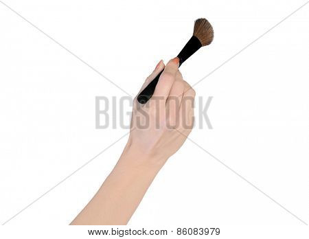 Isolated woman hand holding makeup brush