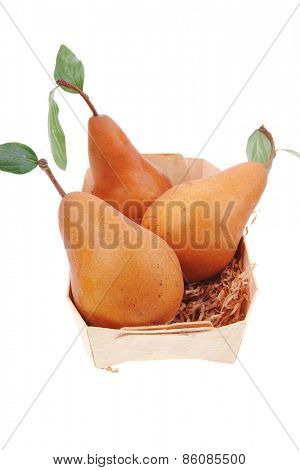 group of gold pear in basket isolated over white background