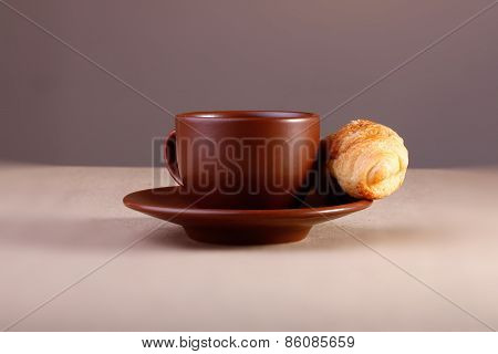 Coffee Cup With Croissant On The Table