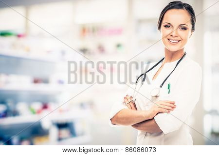 Positive brunette doctor woman in drug store