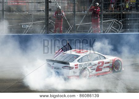 Fontana, CA - Mar 22, 2015:  Brad Keselowski (2) does his burnout after winning the Auto Club 400 at Auto Club Speedway in Fontana, CA.