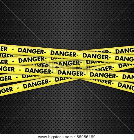 Yellow danger tape on a metallic background