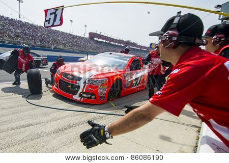 Fontana, CA - Mar 22, 2015:  Justin Allgaier (51) comes in for service during the Auto Club 400 race at the Auto Club Speedway in Fontana, CA.