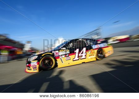 Fontana, CA - Mar 21, 2015:  Tony Stewart (14) takes to the track to practice for the Auto Club 400 at Auto Club Speedway in Fontana, CA.