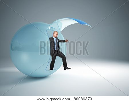 man try to exit from his glass sphere