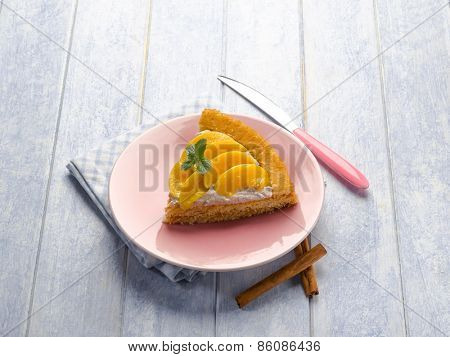 cake with peach and whipped cream
