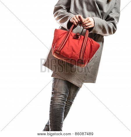 Woman In Gray Coat Holds Red Handbag
