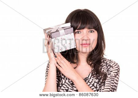beautiful young girl holding present wrapped in a box