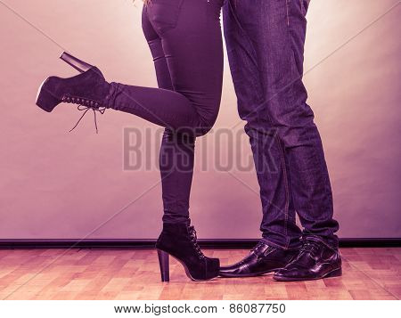 Legs Of Woman And Man.