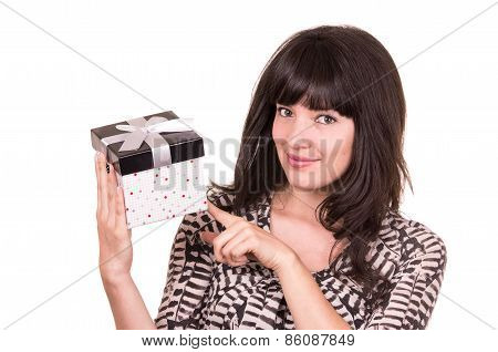 beautiful young happy girl holding present wrapped in a box