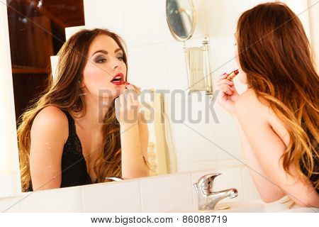 Beautiful Woman With Lipstick In Bathroom.