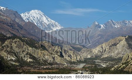 Hongde Airport , Limestone Cliffs And Snow Capped Tilicho Peak