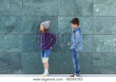 portrait of two fashionable kids, outdoors