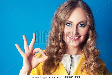 Happy Smiling Young Woman With Okay Gesture