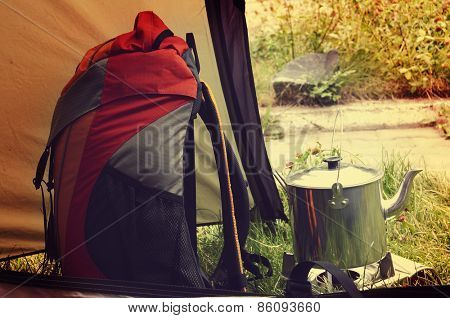 Orange backback and kettle in the tent