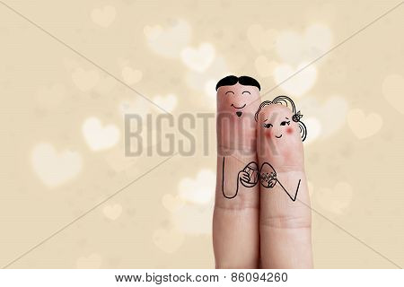 Conceptual Easter Finger Art. Couple Are Holding Painted Eggs. Stock Image
