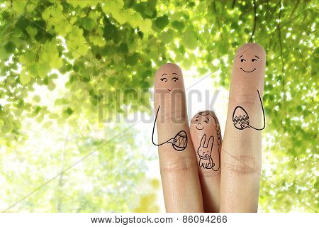 Conceptual Easter Finger Art. Family Are Holding Painted Eggs. Stock Image