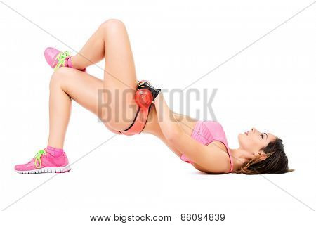 Beautiful sportswomen do exercises for abdominal muscles. Isolated over white.