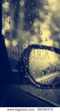 Rain Drops On Car Glass.