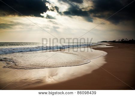 Sunrays over tropical beach