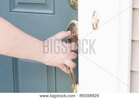 Man's Hand Opening Front Door