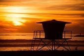 stock photo of lifeguard  - Lifeguard Tower Sunset Silhouette Scenery - JPG