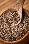 picture of buckwheat  - buckwheat at wooden plate on wooden background - JPG