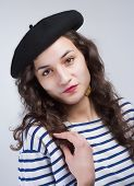 foto of french beret  - Young Beautiful Woman with French Style Beret and Striped T - JPG