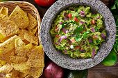 stock photo of mexican  - mexican guacamole in molcajete with tortilla chips - JPG