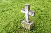 image of empty tomb  - An old cross grave marker in rural Iceland - JPG