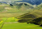 stock photo of plateau  - Piano Grande di Castelluccio (Perugia Umbria Italy) famous plateau in the natural park of Monti Sibillini