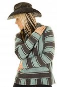 picture of cowgirls  - A cowgirl in her western hat with her arms wrapped around her looking to the side - JPG