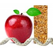 foto of roughage  - Muesli Bars with apple and measuring tape isolated on white background - JPG