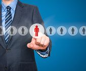 pic of recruiting  - Businessman pressing button on virtual screens - JPG