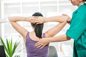 picture of chiropractor  - Chiropractor massage the female patient spine and back - JPG