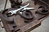picture of ironworker  - Tools and metals in an ironworks shop