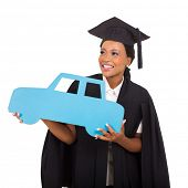 image of car symbol  - gorgeous african american female graduate holding a car symbol on white background - JPG