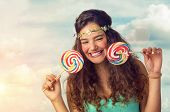 picture of lollipops  - Pretty brunette teenager eager for her big and sweet lollipop - JPG