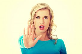 stock photo of gesture  - Woman expressing NO gesture with hand - JPG