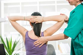 foto of chiropractor  - Chiropractor massage the female patient spine and back - JPG