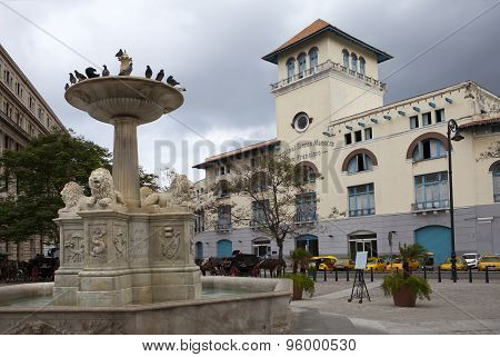 Cuba. Old Havana. Sierra Maestra Havana and fountain of lions on San Francisco Square