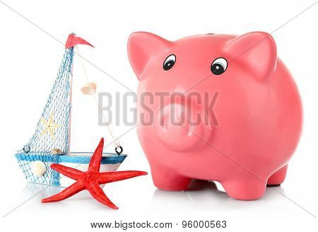 Piggy bank with nautilus and sea star isolated on white