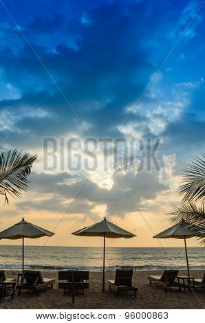 Silhouettes Of Beach Umbrellas Sunset And Sky