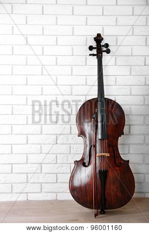 Cello on bricks wall background