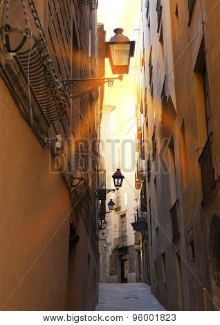 the narrow street with old houses. Barcelona. Spain