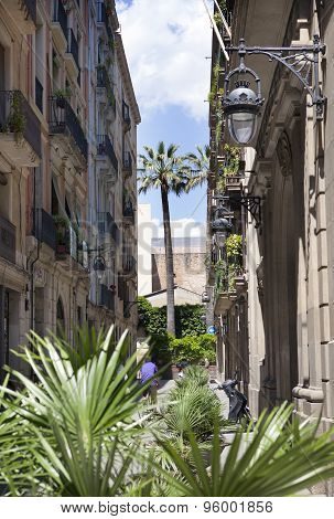 the narrow street with old houses. Barcelona. Spain.
