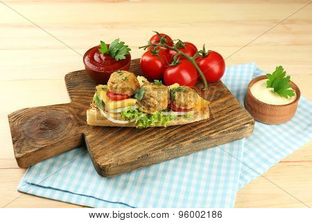 Meatball Sandwich on wooden table background