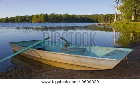 Old boat by the lake shore