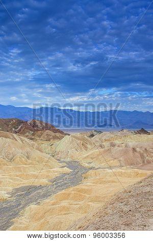 Fanciful Designs Of Zabrislie Point Amargosa Mountain Range In Death Valley In California.