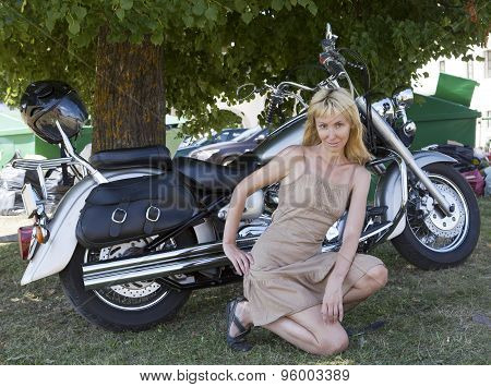 NARVA - 18 JULY: The woman poses near the motorcycle on show motorcycles NARVABIKE in the territory